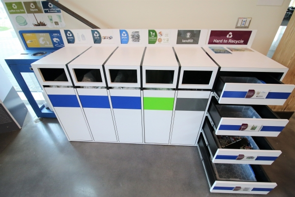 A designated waste, recycling, and composting stations in the building.