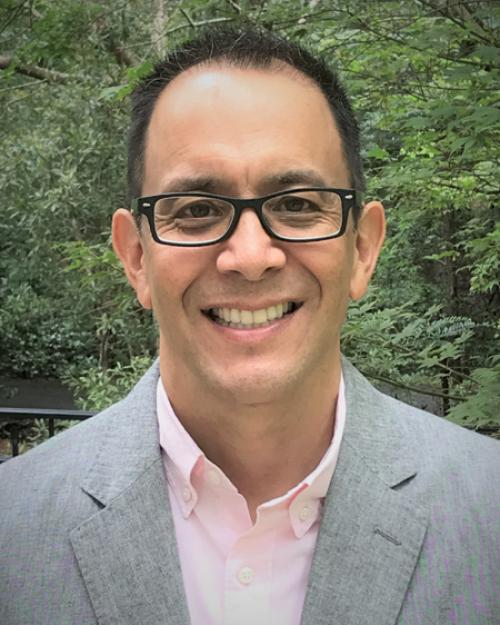 Dr. Michael E. Chang