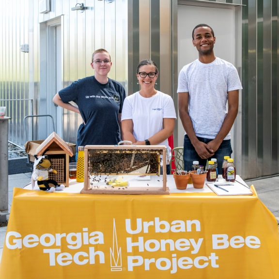 Jennifer Leavey PhD (center), the Director of the Georgia Tech Urban Honey Bee Project, with project partners.