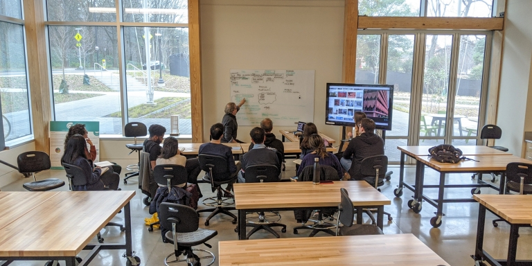 Professor Michael Gamble teaching a course in the design studio.