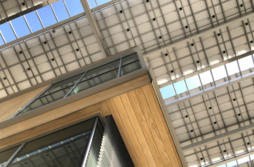 In addition to generating electricity, the solar canopy reduces energy consumption by providing shade for the building. Photo Credit: Miller Hull Partnership.