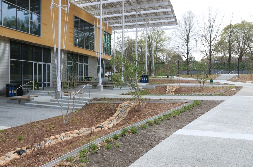 The building is surrounded with pervious surfaces and bioswales that allow for water to slowly seep into the ground.