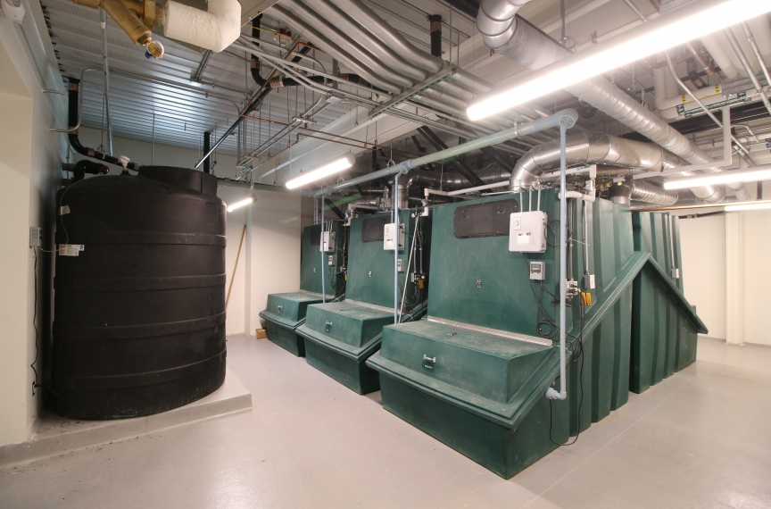 The building's six collection bins and two leachate tanks.