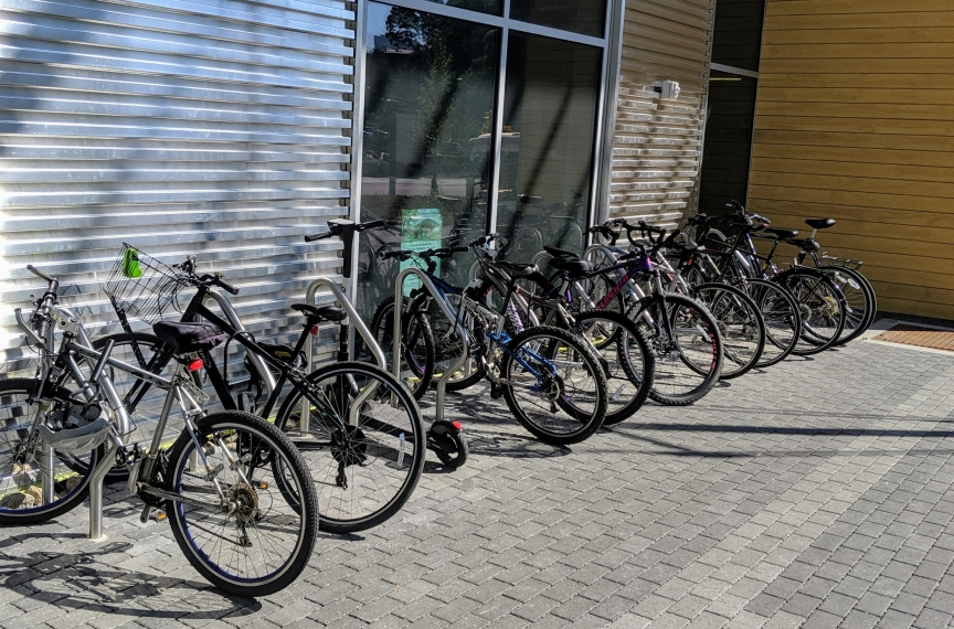 Fully utilized bike racks in front of the building.