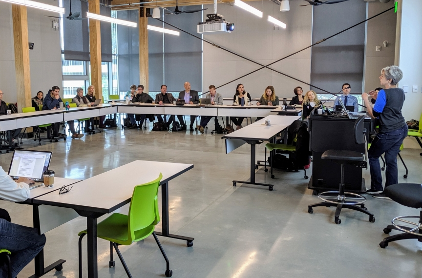 A climate symposium being held in one of the building's classrooms.