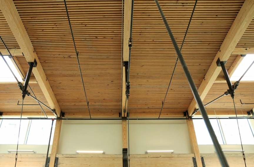 The exposed wood floor/ceiling assembly serves as a constant reminder that we can and should do more to advance equity in the built environment.