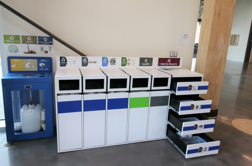 The coffee recycling station alongside one of the indoor materials management stations. The drawers can be extended to place designated hard-to-recycle products.