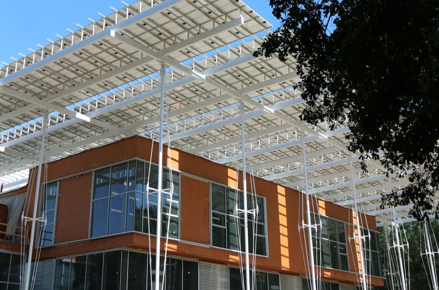The orange layer seen in this image is a fluid-applied air-and-water barrier made by a company that specifically removed red-list materials from its product in order to comply with the Living Building Challenge.