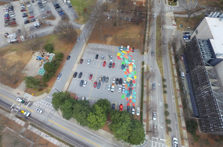 On September 8, 2017 over 50 members of the Georgia Tech community painted a mural on the future Kendeda Building site as part of the Office of Campus Sustainability's Planting the Seeds event series celebrating the building's launch. This event was a nod to the Beauty Petal: it educated student volunteers about the project and beautified the parking lot on which the building would be constructed.